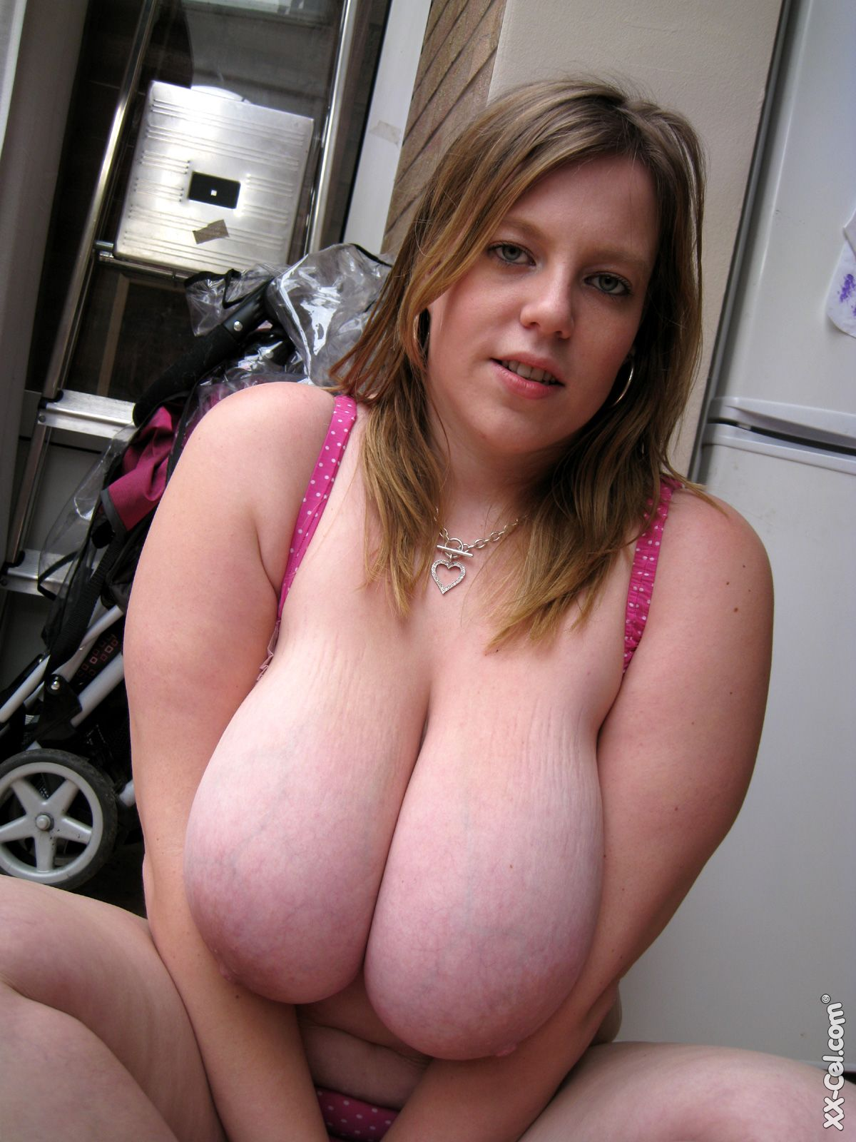 fuck machine huge boobs abused